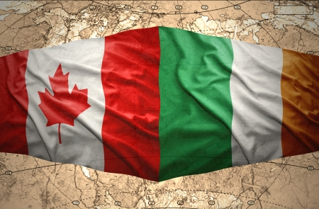 irish map: Waving Irish and Canadian flags of the political map of the world Stock Photo