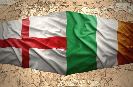irish map: Waving Irish and English flags of the political map of the world