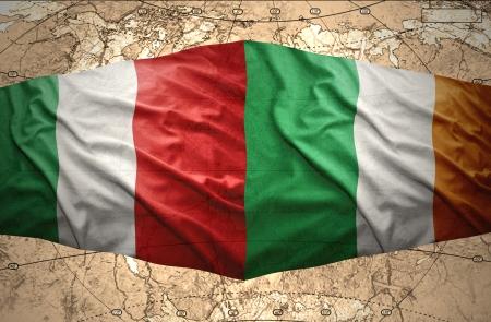 irish map: Waving Irish and Italian flags of the political map of the world Stock Photo
