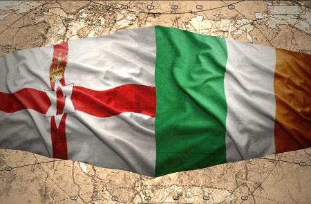 irish map: Waving Irish and Northern Ireland flags of the political map of the world Stock Photo