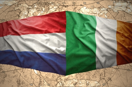 irish map: Waving Irish and Dutch flags of the political map of the world