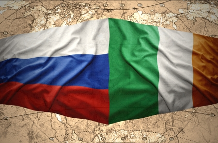 irish map: Waving Irish and Russian flags of the political map of the world
