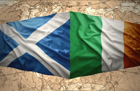 irish map: Waving Irish and Scottish flags of the political map of the world Stock Photo