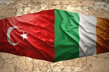 irish map: Waving Irish and Turkish flags of the political map of the world Stock Photo