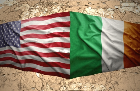 Waving Irish and American flags of the political map of the world Stock Photo