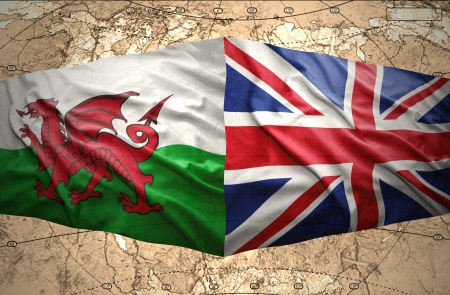 Waving British and Welsh flags of the political map of the world photo