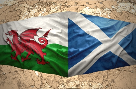 Waving Scottish and Welsh flags of the political map of the world photo