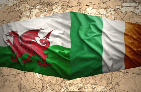 irish map: Waving Irish and Welsh flags of the political map of the world Stock Photo