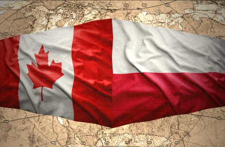Waving Polish and Canadian flags of the political map of the world photo