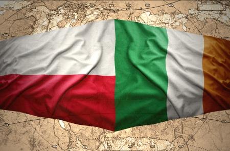 irish map: Waving Polish and Irish flags of the political map of the world Stock Photo