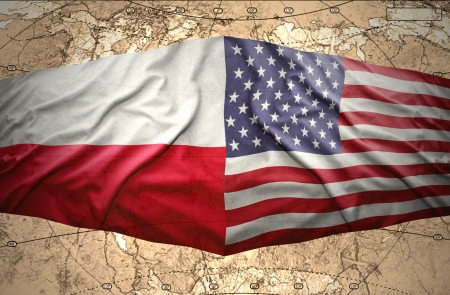 Waving Polish and American flags of the political map of the world photo