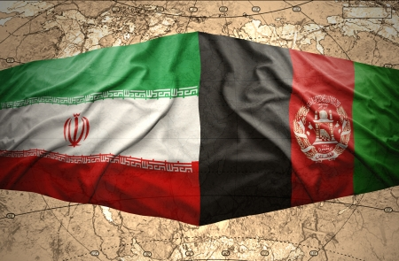Waving Afghanistan and Iranian flags on the of the political map of the world photo