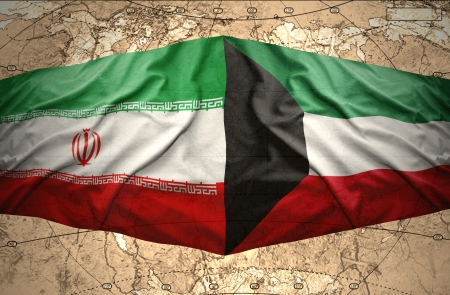 Waving Kuwait and Iranian flags on the of the political map of the world photo