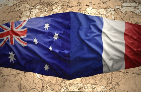 Waving French and Australian flags of the political map of the world photo