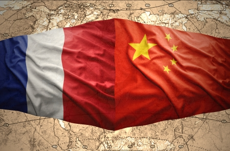 Waving French and Chinese flags of the political map of the world photo
