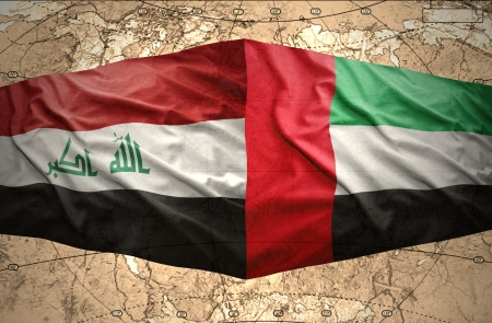 iraq conflict: Waving United Arab Emirates and Iraqi flags on the of the political map of the world Stock Photo