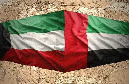 clash: Waving United Arab Emirates and Kuwait flags on the of the political map of the world