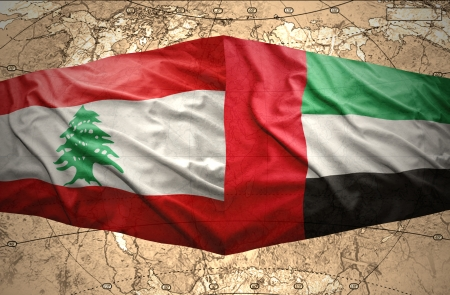 lebanese: Waving United Arab Emirates and Lebanese flags on the of the political map of the world