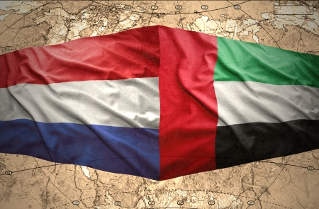 mideast: Waving United Arab Emirates and Dutch flags on the of the political map of the world Stock Photo