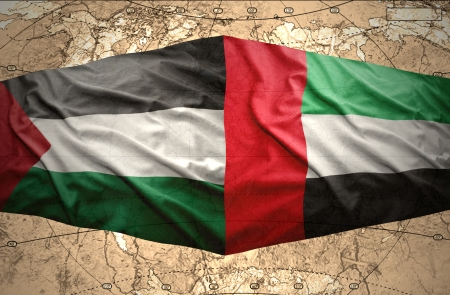 clash: Waving United Arab Emirates and Palestinian flags on the of the political map of the world