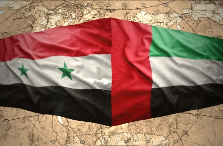 Waving United Arab Emirates and Syrian flags on the of the political map of the world photo