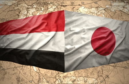 clash: Waving Yemeni and Japanese flags on the of the political map of the world