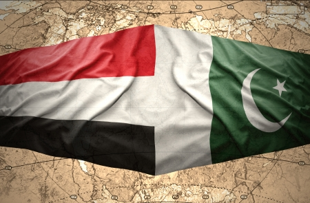 islamabad: Waving Yemeni and Pakistani flags on the of the political map of the world