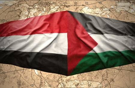 clash: Waving Yemeni and Palestinian flags on the of the political map of the world