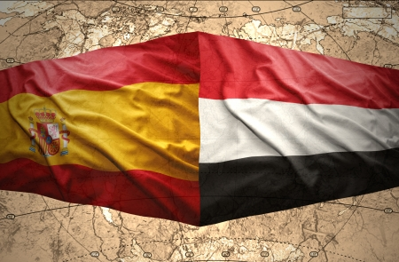 Waving Yemeni and Spanish flags on the of the political map of the world photo