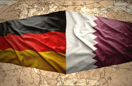 mideast: Waving Qatar and German flags on the of the political map of the world
