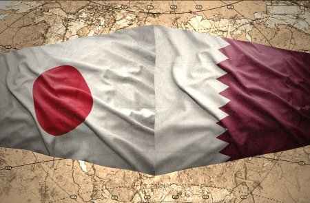 mideast: Waving Qatar and Japanese flags on the of the political map of the world
