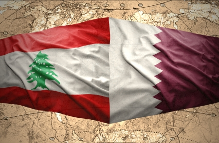 lebanese: Waving Qatar and Lebanese flags on the of the political map of the world