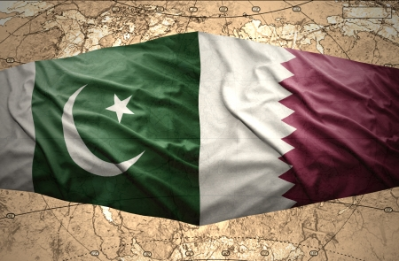 mideast: Waving Qatar and Pakistani flags on the of the political map of the world