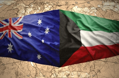 mideast: Waving Kuwait and Australian flags on the of the political map of the world