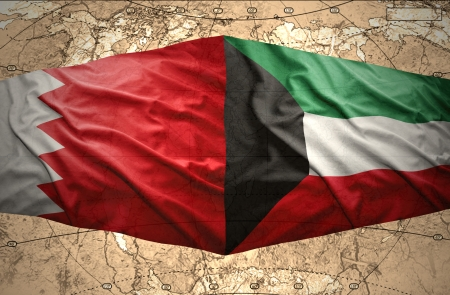 Waving Kuwait and Bahraini flags on the of the political map of the world photo