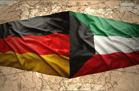 east berlin: Waving Kuwait and German flags on the of the political map of the world Stock Photo