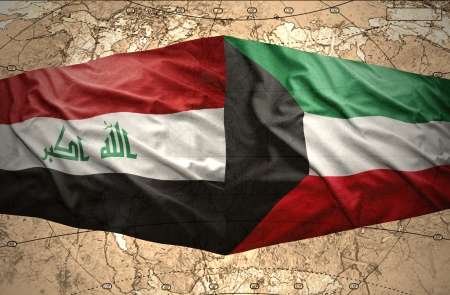 iraq conflict: Waving Kuwait and Iraqi flags on the of the political map of the world