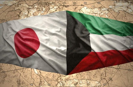 mideast: Waving Kuwait and Japanese flags on the of the political map of the world