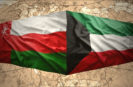 mideast: Waving Kuwait and Omani flags on the of the political map of the world