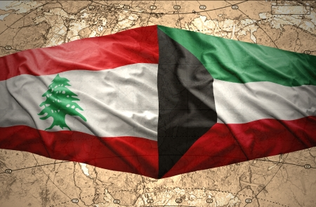 lebanese: Waving Kuwait and Lebanese flags on the of the political map of the world