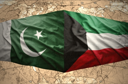 mideast: Waving Kuwait and Pakistani flags on the of the political map of the world