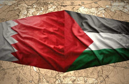 palestinian: Waving Palestinian and Bahraini flags on the of the political map of the world