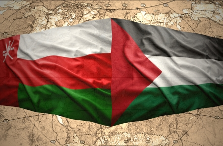 mideast: Waving Palestinian and Omani flags on the of the political map of the world