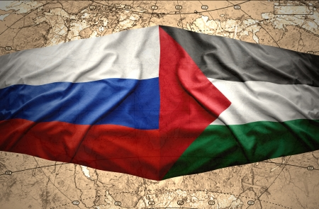 Waving Palestinian and Russian flags on the of the political map of the world photo