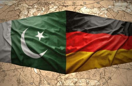 clash: Waving Pakistani and German flags on the of the political map of the world
