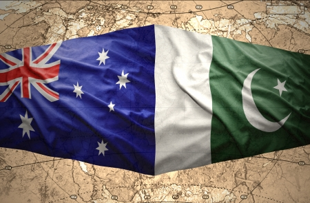 Waving Pakistani and Australian flags on the of the political map of the world photo
