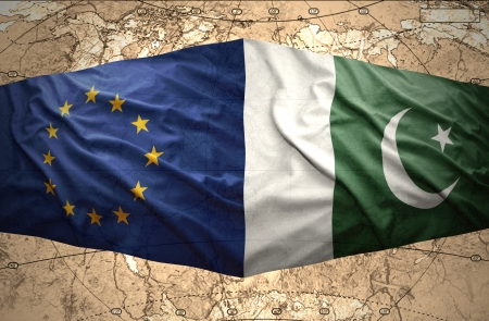 mideast: Waving Pakistani and European Union flags on the of the political map of the world Stock Photo