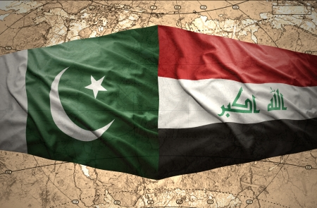 iraq conflict: Waving Pakistani and Iraqi flags on the of the political map of the world Stock Photo