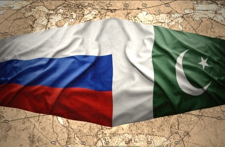 islamabad: Waving Pakistani and Russian flags on the of the political map of the world