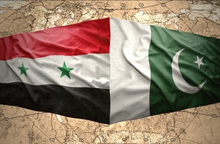 Waving Pakistani and Syrian flags on the of the political map of the world photo